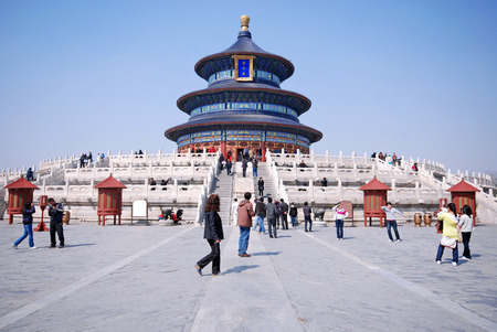 BEIJING, CHINA - MARCH 27,2010: Visitors at the Temple of Heaven in Beijing, China. The religious complex Temple of Heaven was inscribed as a UNESCO World Heritage Site.
