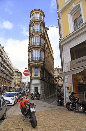 nice accommodations: NICE, FRANCE - MAY 14: Narrow streets and Hotel Acanthe located in the old historical center of Nice, France next to Massena square on May 14, 2013. Editorial