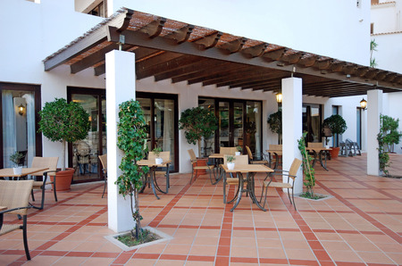 Beautiful view with tables and chairs at a open terrace cafe (Algarve, Portugal) photo