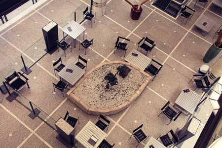 Tables and chairs in contemporary cafe, view from above photo
