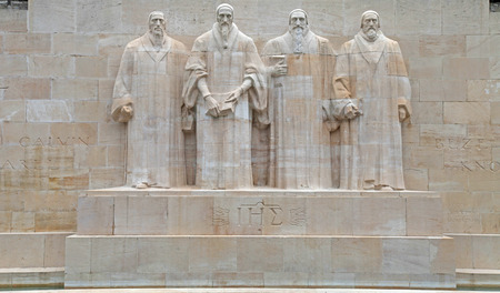 Reformation wall in Parc Des Bastions, Geneva, Switzerland. Sculptures of the four great figures of the geneva protestant movement : Guillaume Farel (1489 - 1565), Jean Calvin (1509-1564), Theodore de Beze (1513-1605) and John Knox (1513-1572) , Geneva, S
