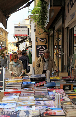 NICE, FRANCE - MAY 14, 2013: People searching for books on street book stalls in May 14, 2013 in Nice, France.