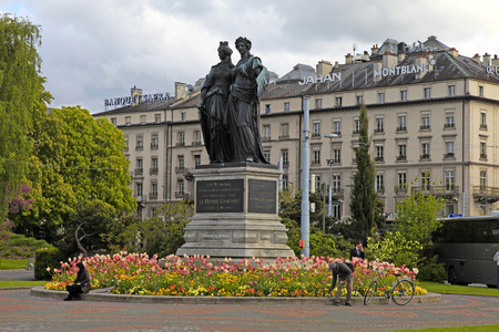 helvetia: GENEVA, SWITZERLAND - MAY 10, 2013: The National Monument with Geneva and Helvetia from 1869 in Geneva, Switzerland. Editorial