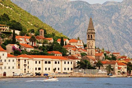 PERAST, MONTENEGRO - JULY 18, 2010: Beautiful landscape with mediterranean town - Perast, Kotor bay (Boka Kotorska), Montenegro.