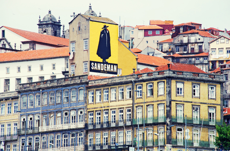PORTO, PORTUGAL - MAY 06, 2009: View of old multicolored buildings with Sandeman Advertising Signboard,Porto, Portugal