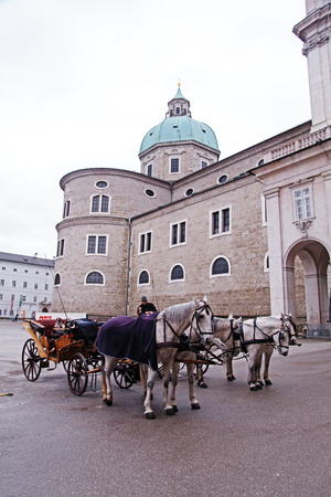 SALZBURG, AUSTRIA - JANUARY 05, 2013: Carriage horses waiting for tourists in Salzburg, Austria