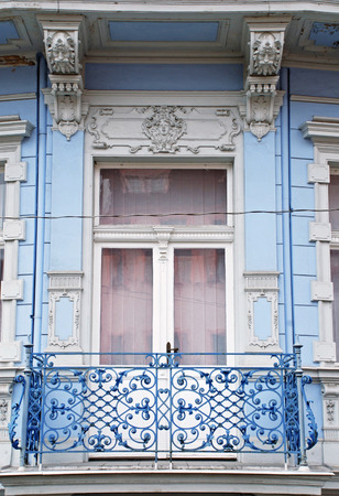 balcony window: Ornate baroque window with a balcony in old blue building, Carlovy Vary, Chech Republic