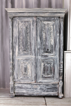 hand crafted: Hand crafted grey wooden wardrobe Stock Photo