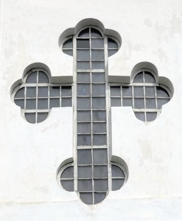 church window: cross shape orthodox church window, Ukraine  Stock Photo