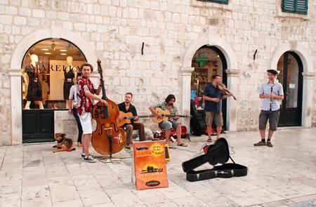 busker: DUBROVNIK, CROATIA - JULY 21, 2011: Street musicians performing in the main street Stradun of the Old Town of Dubrovnik, Croatia. Editorial