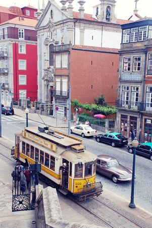 electrico: PORTO, PORTUGAL - MAY 06, 2009: Retro tram goes by the street of Porto historical centre in Porto, Portugal. Porto is the second largest city in Portugal and it was called the European Culture Capital in 2001 Editorial