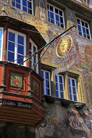 STEIN AM RHEIN, SWITZERLAND - MAY 05, 2013: Old beautiful fresco and signboard of hotel on medieval building in Stein am Rhein, Switzerland