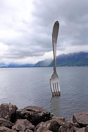 vevey: VEVEY, SWITZERLAND - MAY 10,2013: Giant steel fork in water of Geneva lake, Vevey, Switzerland Editorial