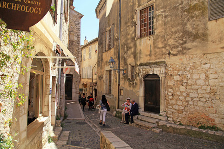 SAINT-PAUL-DE-VENCE, FRANCE - MAY 12,2013: Tourists walk in the medieval town Saint-Paul-de-Vence, Provence, France. One of the oldest medieval towns on the French Riviera, it is well known for its modern and contemporary art museums and galleries