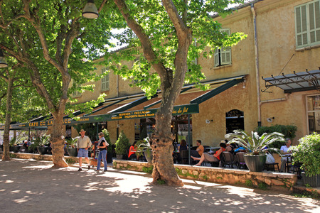 SAINT-PAUL-DE-VENCE, FRANCE - MAY 12,2013: outdoor cafe in the medieval town Saint-Paul-de-Vence, Provence, France. One of the oldest medieval towns on the French Riviera, it is well known for its modern and contemporary art museums and galleries