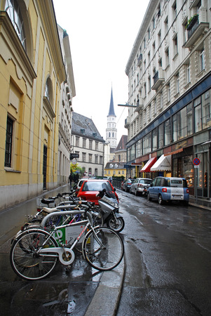 VIENNA, AUSTRIA - OCTOBER 15,2008: City view with bike station at rainy day in historic center of Vienna, Austria.