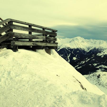 Wooden terrace at mountain ski resort in Alps, Austria.    photo