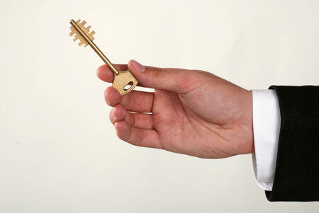 Businessman with a key in his hand photo