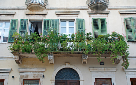 old towns: Beautiful shatter windows and balcony in mediterranean medieval house (Kotor, Montenegro).Kotor has one of the best preserved medieval old towns in the Adriatic and is a UNESCO world heritage site.