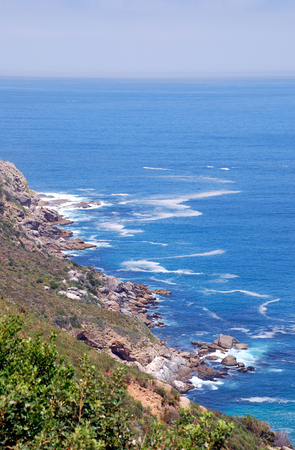 Cape Point, where the Indian Ocean meets the Atlantic, at the tip of the Cape Peninsula, South Africa. Vertical image photo