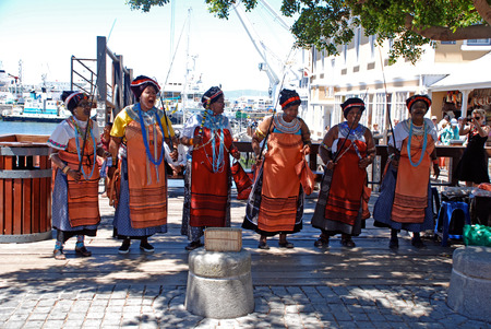 capetown: CAPE TOWN, SOUTH AFRICA - DECEMBER 30, 2007: African tribal female singers on the Victoria and Albert Waterfront in Capetown, South Africa. Editorial