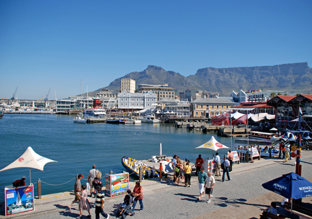 capetown: CAPE TOWN, SOUTH AFRICA - DECEMBER 30, 2007: Victoria and Alfred Waterfront, harbor with recreation boats, shops, restaurants and Table Mountain on background in Cape Town, South Africa.