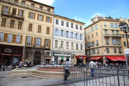 NICE, FRANCE - MAY 14, 2013: Local people and tourists at Old Town district, near Cours Saleya, most famous City Market, famous location of many cafes and restaurants, Nice, France.