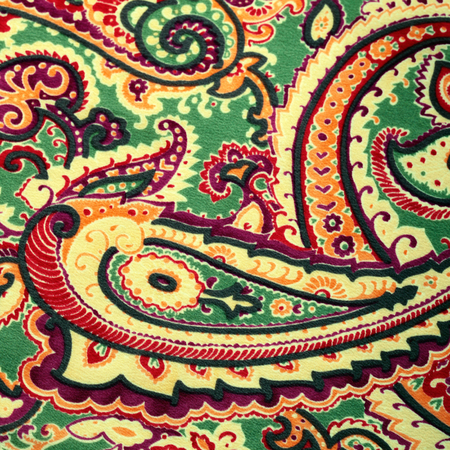 Fragment of traditional paisley pattern silk fabric background, square toned image photo