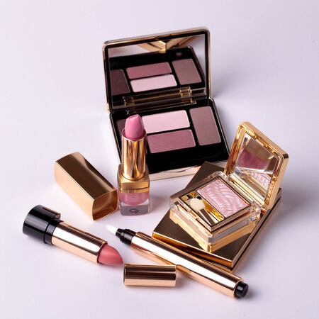 Luxury eyeshadow palette with mirror and lipsticks in pink and beige colors. Square image photo