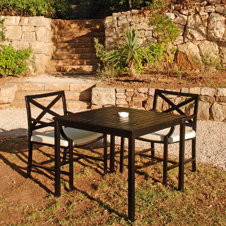 Table and chair in beautiful outdoor cafe alfresco, Italy. square image