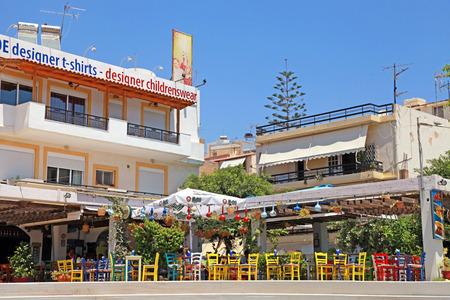 AGIOS NIKOLAOS, GREECE - JULY 18, 2012: Outdoor cafe with colorful chairs in Agios Nikolaos on the Island of Crete , Greece.