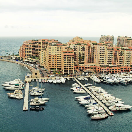 cote d'azur: Panoramic landscape with harbor,pier and lots of yachts in famous Monte Carlo, Cote dAzur.
