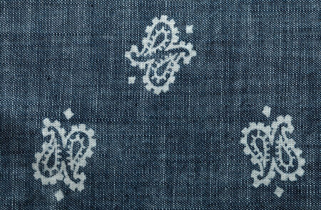 Close up background grey denim texture with pattern, vintage toned image photo