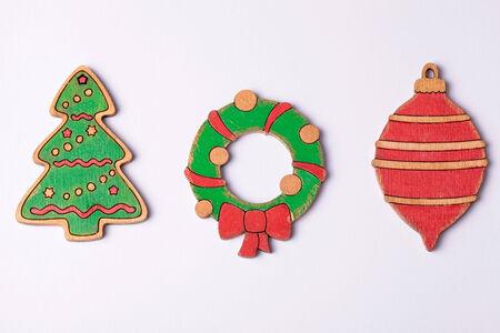 Handmade painting wood christmas decoration on white background photo