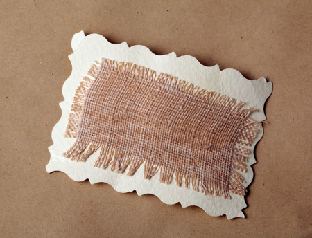 close up mesh texture on brown recycled kraft paper background photo