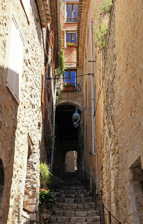 vence: Narrow street with steps in medieval Saint Paul de Vence, one of the oldest towns of Provence, France, famous town of painters and galleries