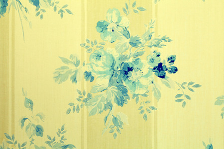 Vintage victorian wallpaper with blue flowers floral pattern, toned image photo