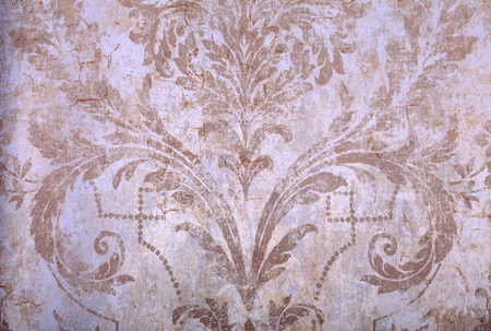 victorian wallpaper: Detail of vintage beige rundown victorian wallpaper with baroque vignette