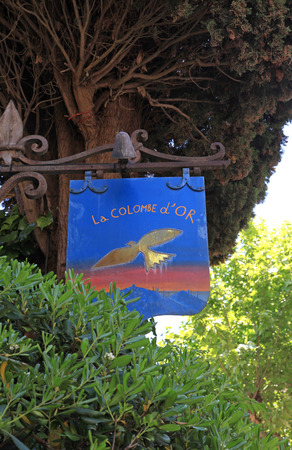 frence: SAINT-PAUL-DE-VENCE, FRANCE - MAY 12, 2013: Sign of the famous local restaurant  La colombe dOr in Saint Paul de Vence, one of the oldest towns of the Frence Riviera. Editorial
