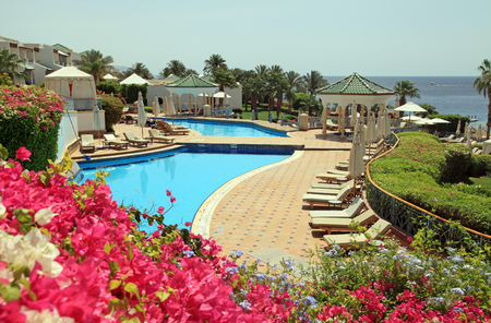 SHARM EL SHEIKH, EGYPT - MAY 03, 2014: Tropical luxury resort hotel with pool on Red Sea beach in Sharm el Sheikh, Egypt.