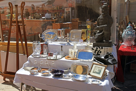 collectibles: NICE, FRANCE - MAY 13,2013:Cours Saleya at the French Riviera famous of antique market every Monday in Nice, France. Huge variety of collectibles is on offer: silver, crystal,ceramics, paintings,etc Editorial