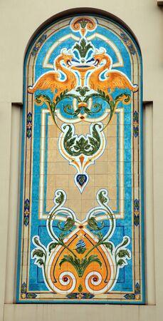 montecarlo: MONTE-CARLO, MAY 15, 2013: An antique Art Nouveau design majolica tile on the historic building, Monte-Carlo, Monaco.