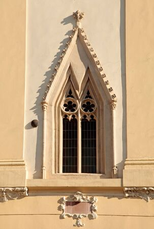 church window: Ornate gothic window at the wall of the medieval church, Bratislava Stock Photo