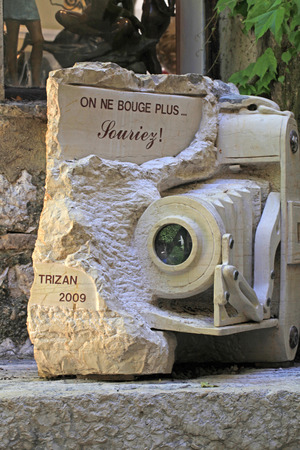 vence: SAINT-PAUL-DE-VENCE, FRANCE - MAY 12, 2013: Art monument of the vintage camera, Saint Paul de Vence, Provence, France, famous town of painters and galleries