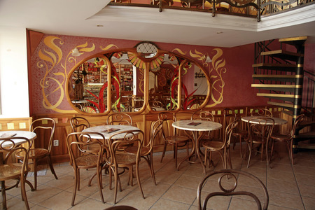 BRATISLAVA, SLOVAKIA - FEBRUARY 3, 2015:The old cafe interior in typical Viennese style with historical chairs and art deco decoration, Bratislava, Slovakia