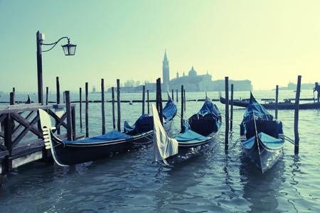 saint mark square: Gondolas moored by Saint Mark square with San Giorgio di Maggiore church in the background - Venice, Venezia, Italy