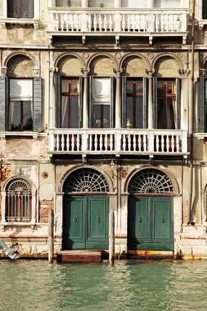 canal house: Facade of typical medieval house on Grand canal, Venice, Italy Editorial