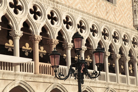 doges  palace: Venetian gothic architecture on The Doges Palace (Italian Palazzo Ducale) balustrade, Venice, Italy. Palace was largely constructed from 1309 to 1424.