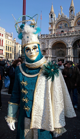 mardigras: VENICE, ITALY - FEBRUARY 8, 2015: Unidentified masked person in costume on San Marco Square during the Carnival in Venice, Italy.
