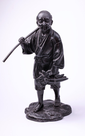 peasant: Chinese metal old man peasant statue on white background
